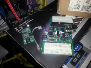 Some PIC dev boards, ancient... comes with PicBASIC software cd, rs232 programmer, etc