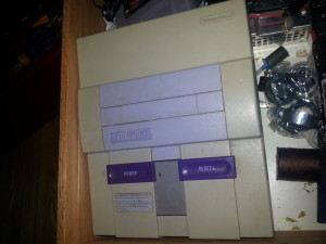 Super Nintendo, has a power supply issue.  Complete with 1 controller and some aladdin game
